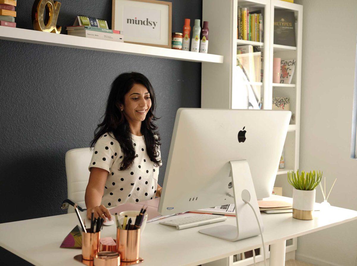 Asha Mody at her desk